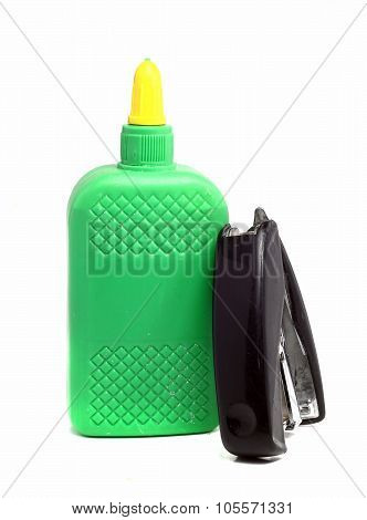 Bottle Of Glue And Old Stapler On A White Background