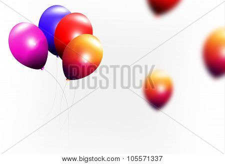 Blue orange red and purple balloons flying in the air.