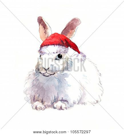 New year rabbit in red santa's hat. Watercolor christmas animal