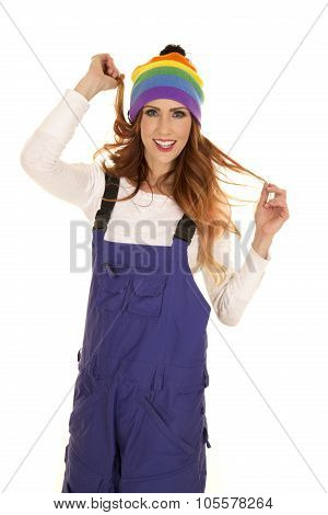 Woman With Red Hair In Coveralls And Hat Play With Hair