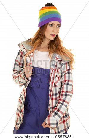 Woman With Red Hair In Coveralls And Hat Stand Look To Side