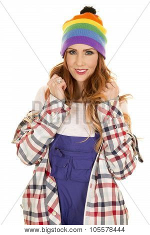 Woman With Red Hair In Coveralls And Hat Stand Smiling