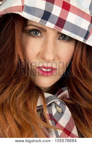 Woman With Red Hair In Plaid Hood Close Small Smile Looking