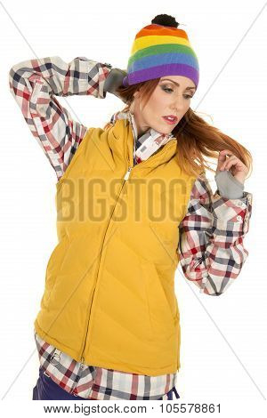 Woman With Red Hair In Yellow Vest And Hat Look Down