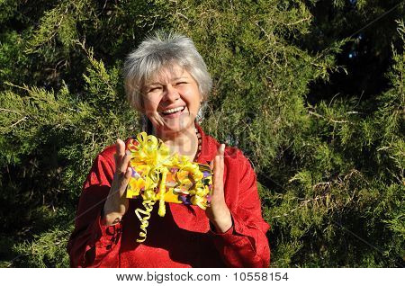 A happy, middle-aged woman holding