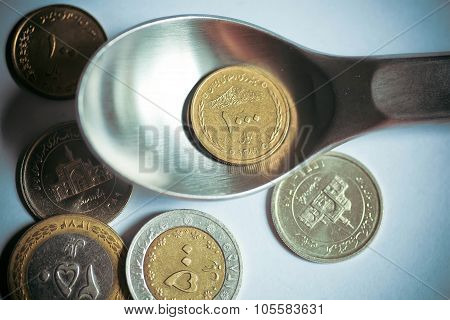 Selective Focus On One Thousand Iranian Rials On A Dinner Spoon
