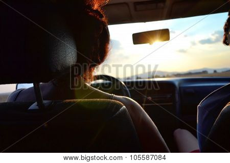 Woman Driving A Car In The Summer At Sunset