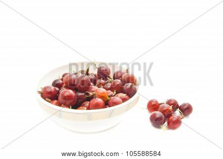 Red Gooseberries On A Dish On White