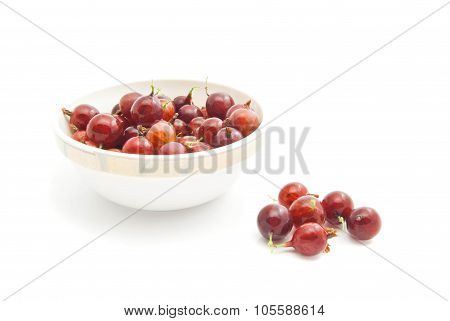 Red Gooseberries On A Dish