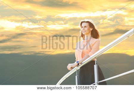Business Woman Stands Near Railing