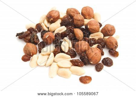 Hazelnuts, Peanuts And Raisins On White