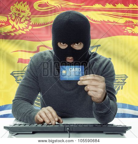 Dark-skinned Hacker With Canadian Province Flag On Background Holding Credit Card - New Brunswick