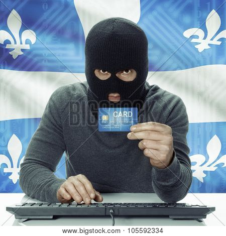 Dark-skinned Hacker With Canadian Province Flag On Background Holding Credit Card - Quebec