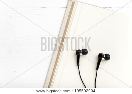 Notebook And Ear Phone