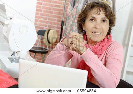 Portrait of happy dressmaker woman in studio
