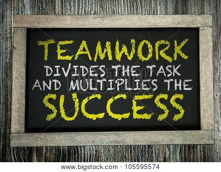 Teamwork Divides the Task and Multiplies the Success written on chalkboard