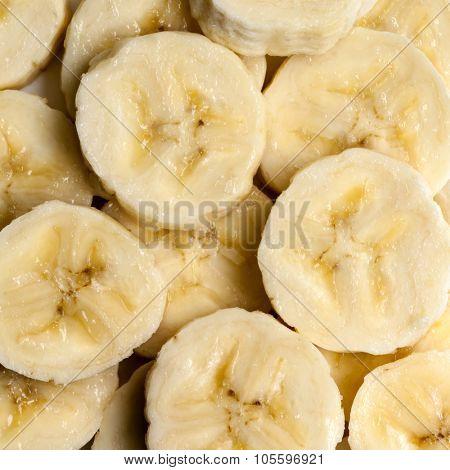 Banana slices, overhead view, full frame.