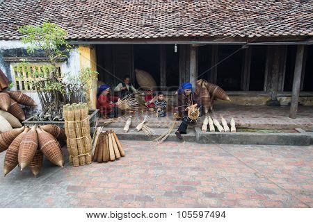 Unidentified women were weaving bamboo in HungYen, Vietnam