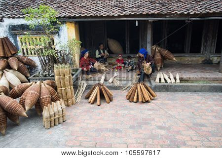 Unidentified women were weaving bamboo in HungYen, Vietnam