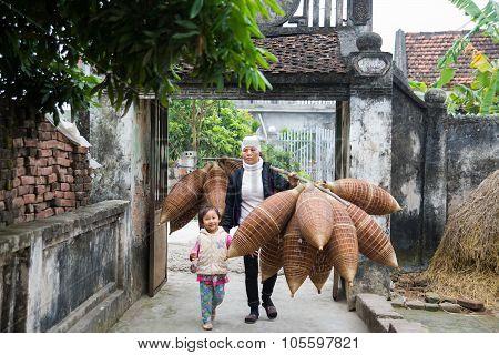 Unidentified women were weaving bamboo in HungYen, Viet
