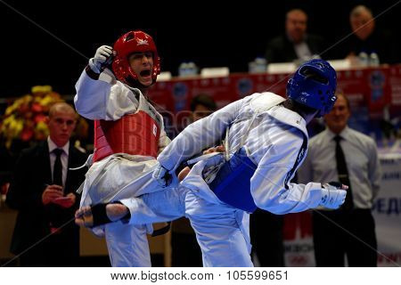 ST. PETERSBURG, RUSSIA - OCTOBER 17, 2015: Taekwondo WTF junior teams match Russia vs Iran during the martial arts festival Baltic Sea Cup in Sibur Arena. Iran won the match