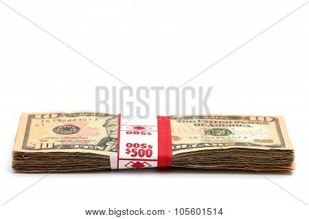 A Stack Of Ten Dollar Bills Isolated On A White Background