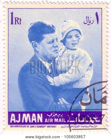 Ajman - Circa 1967: A Postage Stamp Printed In Ajman Dedicated 50Th Anniversary Of Usa President Joh