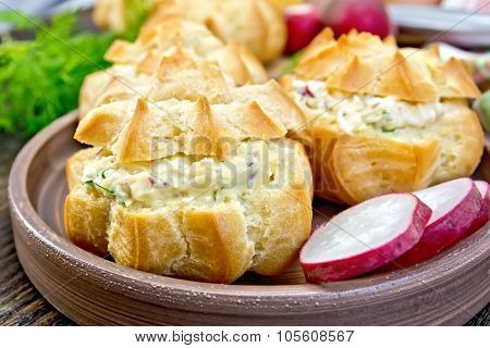 Appetizer Of Radish And Cheese In Profiteroles On Plate With Dill