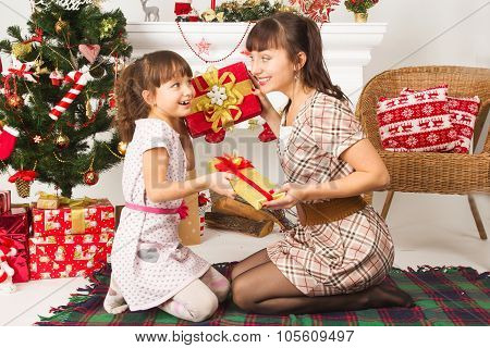 family exchanging gifts at Christmas