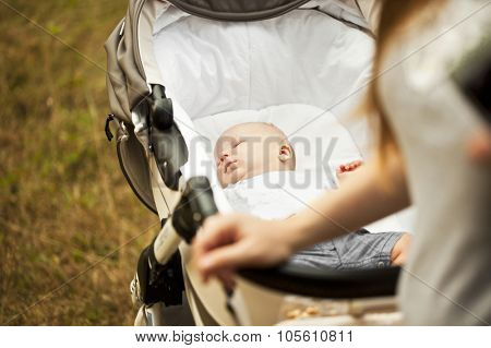 Baby sleep in carriage on nature