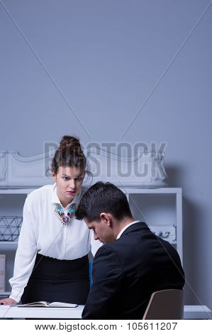 Powerful Woman Reprimanding Male Employee