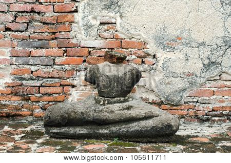 Old damaged Buddha