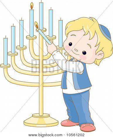 Jewish Boy Lighting Chanukah Menorah
