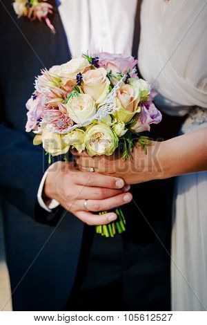 Beautiful Bridal Bouquet. Bride's And Groom's Hands Close-up