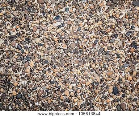 Many Little Stone Are In Concrete Floor Background