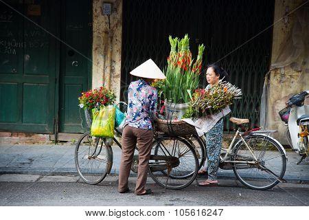 Unidentified street vendor on in Hanoi, Vietnam.