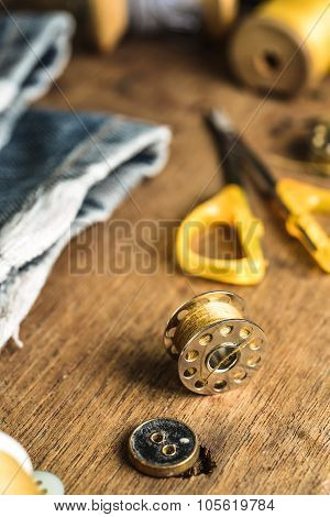 Sewing tools and sewing kit on grunge wood background