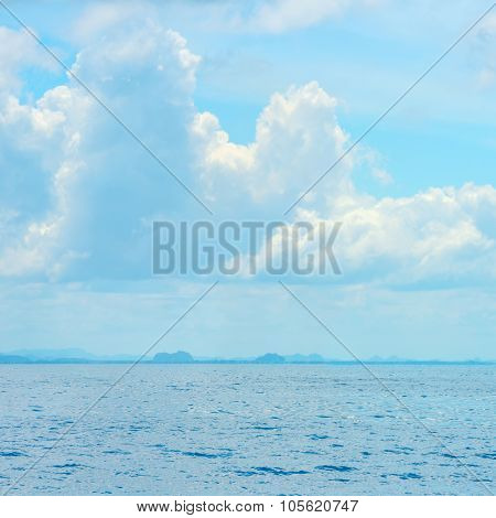 Beautiful Blue Sea And Clouds On Sky With Big Steamship