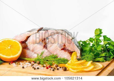 Raw Sliced Steak Of Sturgeon Fish With Greens, Lemon, Different Peppers And Sea Salt, Closeup