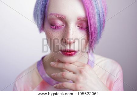 young girl with pink eyes and hair, like a doll