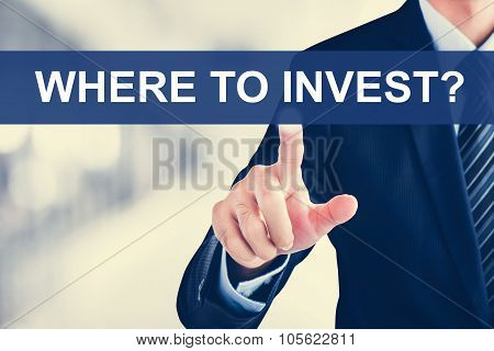 Businessman Hand Touching Where To Invest? Tab On Virtual Screen