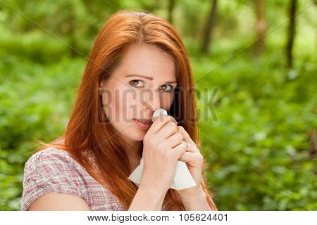 Woman is sneezing