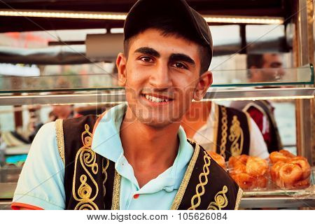 Young Street Food Vendor In The Traditional Turkish Clothes