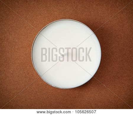 Round Candle On The Brown Background