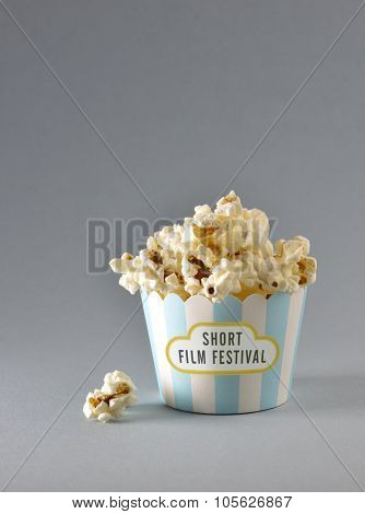 'Short film festival' title printed on miniature popcorn bucket. An idea.