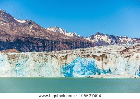 Massive glacier descends into the water.  The picturesque  shore of Lake Viedma. In the water ice-floes, broken away from a glacier