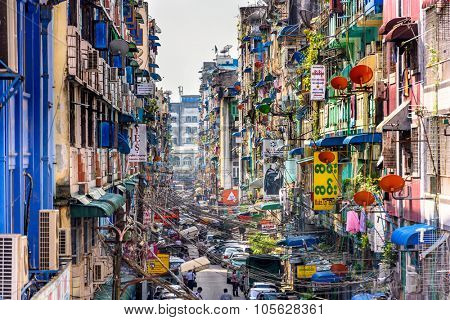 YANGON, MYANMAR - OCTOBER 18, 2015: Alleyway in Yangon in front of Bogyoke Market. Yangon is the country's largest city.