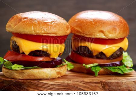 Homemade Cheeseburgers top with onion, tomato, lettuce and chees