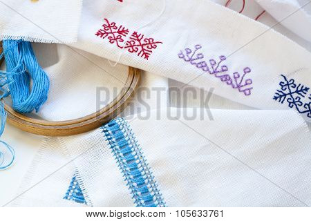 Samples Ukrainian embroidery, unfinished work in progress and tools for embroidery