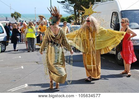 ST.LEONARDS-ON-SEA, ENGLAND - JULY 11, 2015: Costumed people take part in the parade at the annual St.Leonards Festival in Warrior Square. The free entertainment event was first held in 2006.